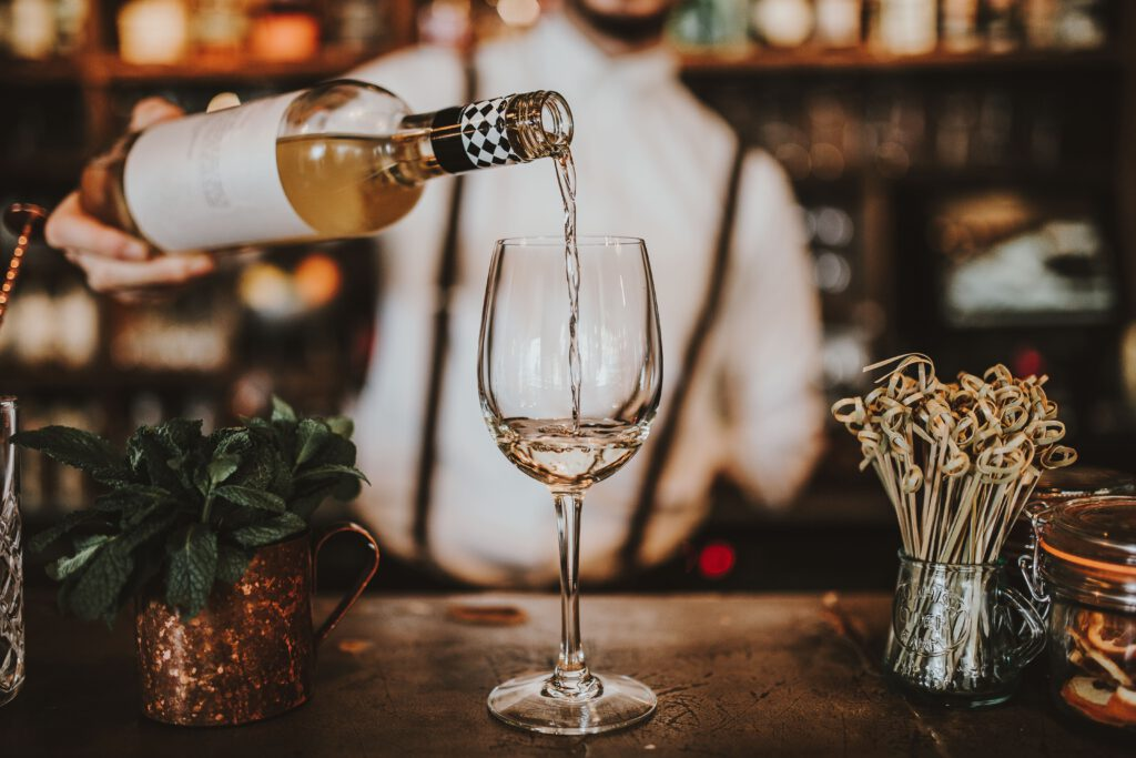 bar pouring cold white wine
